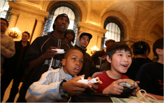 Kids enjoyed video games on Wii, Xbox 360 and Playstation 3 at the main branch of the New York Public Library on Friday. (Photos: Suzanne DeChillo/The New York Times)